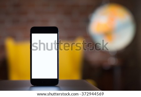Mobile smart phone with blank screen,blur image on back - stock photo