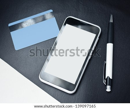 mobile smart phone with credit card - stock photo