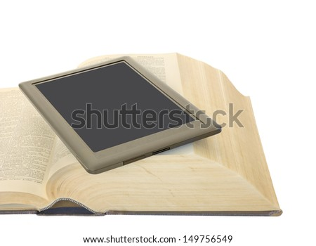 Mobile technology e reader and one open heavy hardcover book. Convenient, portable modern learning.Electronic tablet on top of an old heavy dictionary. Horizontal photo. Isolated on a white background - stock photo