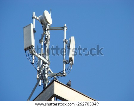 Mobile Telecommunication tower  on the roof - stock photo