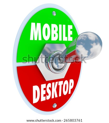 Mobile Vs Desktop words on a toggle switch to illustrate the trend of viewing content and ordering products on the go via smart phones, computer tablets and other mobility devices - stock photo