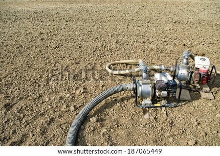 Mobile water pumps on dry agriculture land - stock photo