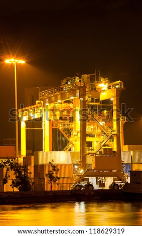 Mobility Crane car in commercial container cardo port for shipping - stock photo