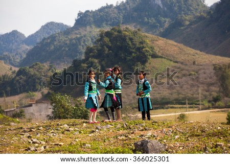 moc chau, son la, vietnam, jan 10,2016: H'mong children playing in Tet Holidays. In time Hmong New Year at the end of the Lunar year, they often wear the most beautiful costumes, the most brilliant