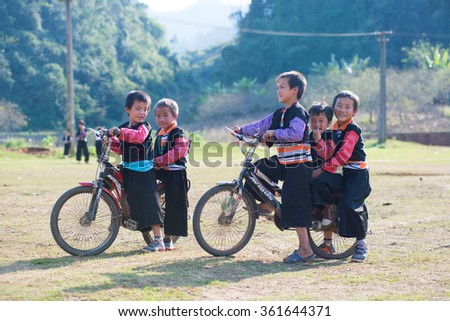 MOCCHAU, VIETNAM, JANUARY 2, 2016: H'mong ethnic children in traditional custome in H'mong holiday. H'mong is the 8th largest ethnic group in Vietnam.