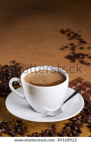 mocha coffee with coffee bean and chocolate on table - stock photo