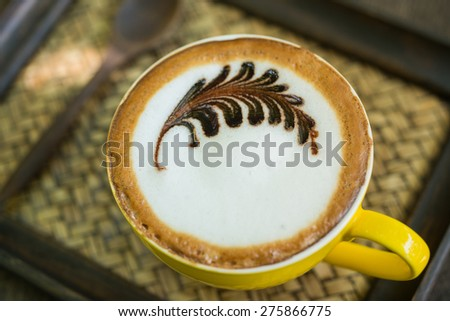 Mocha coffee with hot milk in coffee, beautiful makeup. - stock photo