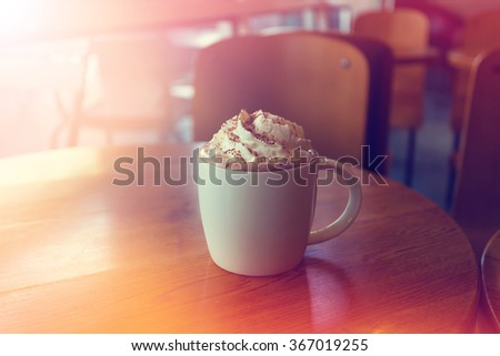 Mocha coffee with whipped cream made with Vintage Tones,Warm tones - stock photo