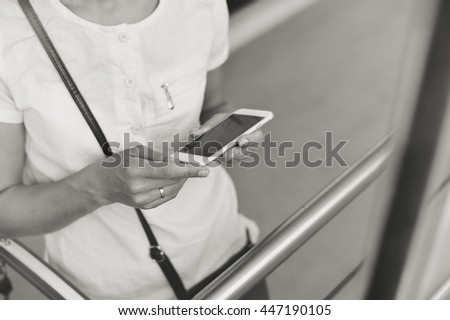 Mock up display. Person holding mobile smart phone in hand during shopping. Cart on store background, closeup top view - stock photo