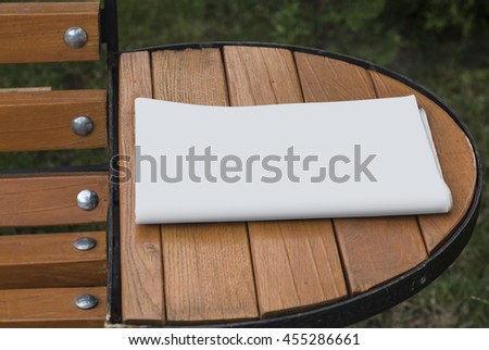 Mock-up newspaper Newspapers on the table, cover for your design. Most realistic cover on wood background.