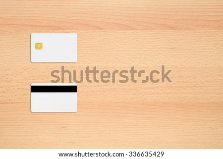 Mock-up of credit card on office desk with copy-space - stock photo