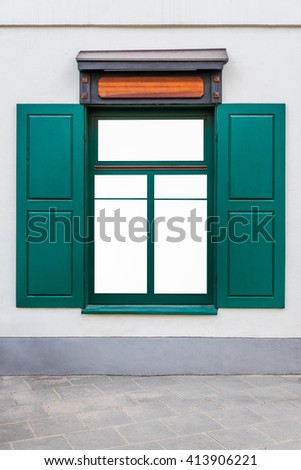 Mock up of store window with green shutters