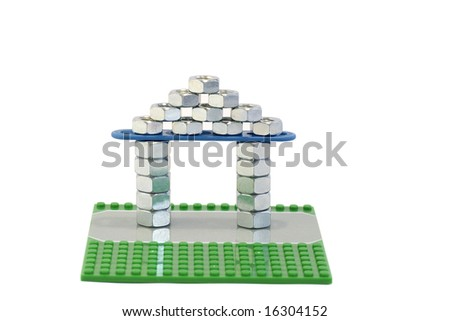 Mock-up of the house of that built from the nuts against the white background - stock photo