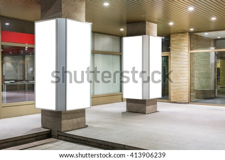 Mock up of two vertical lightboxes in city space at night - stock photo
