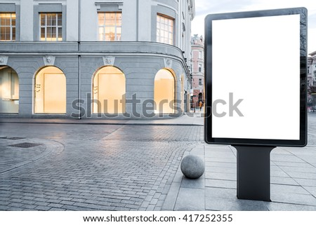 Mock up of vertical street billboard in empty city street - stock photo