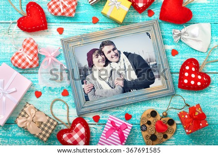 Mock up template frame for Valentine's day with heart shapes. Happy young couple in picture frame. Valentine's Day beautiful background