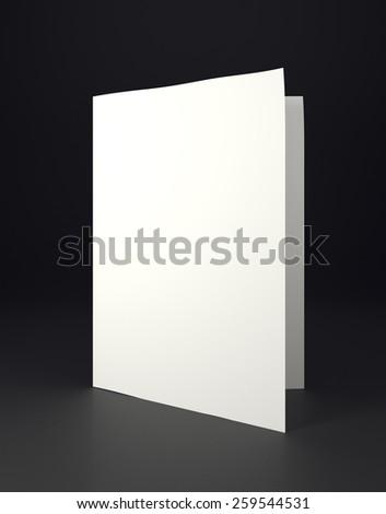 Mock up white folded paper on black background - stock photo