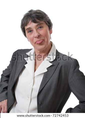 mocking mature woman sticking out tongue isolated on white background - stock photo