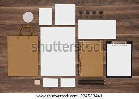 Mockup business template with shopping bag, notepads and envelopes. Natural wooden background. - stock photo