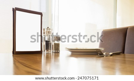 Mockup Menu design template on Table in restaurant cafe with Clipping path for edit - stock photo