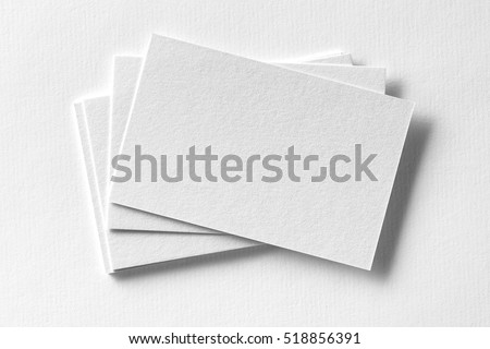 Mockup business cards fan stack white stock photo download now mockup of business cards fan stack at white textured paper background reheart Image collections