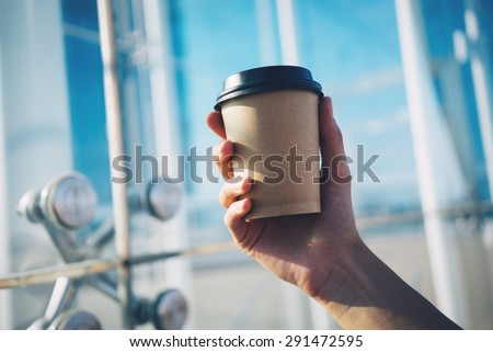 mockup of coffe cup holding in hand - stock photo