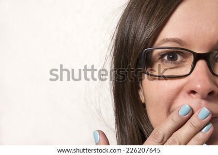 Mod aged woman in glasses surprised, studio shot  - stock photo