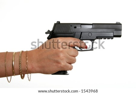 model aiming a 9mm handgun to the right - stock photo