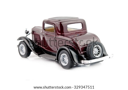 model antique car, isolated on a white background - stock photo
