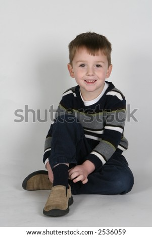 model boy sitting and smiling