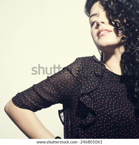 Model brunette with long curly hair. sensual brunette woman with shiny curly silky hair studio shot. - stock photo