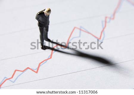 Model Businessman Studying Graph