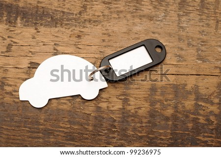 model car with blank tag on wooden background. space for your text - stock photo