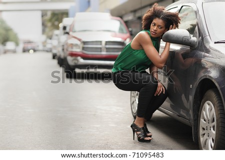 Model checking her makeup in the car mirror - stock photo