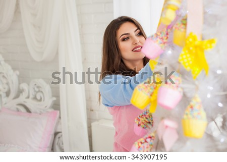 Model decorating fir-tree with christmas decorative toys