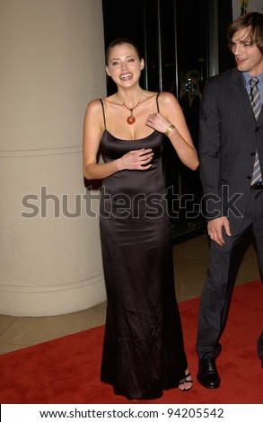 Model ESTELLA WARREN & actor boyfriend ASHTON KUTCHER at the Hollywood Film Festival's Hollywood Movie Awards and Gala Ceremony, in Beverly Hills. 07OCT2002.  Paul Smith / Featureflash - stock photo