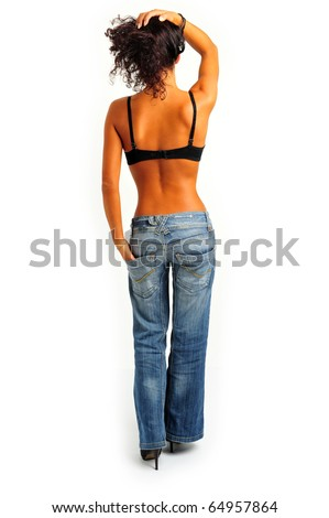 model from behind in blue jeans, high heels and lingerie - stock photo