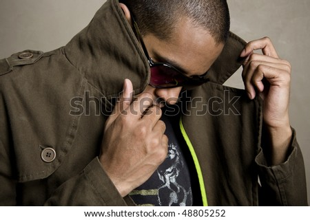 Model gets involved with his brown jacket - stock photo