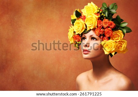 Model Girl with Flowers Hair. Hairstyle. Fashion Beauty Woman with Yellow Roses