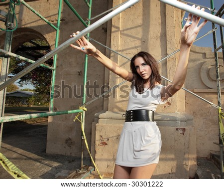 Model holding on to scaffolding