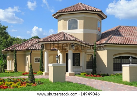 Model home entrance with a beautiful blue sky - stock photo