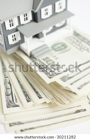 Model Home on top of One Hundred Dollar Bills - stock photo