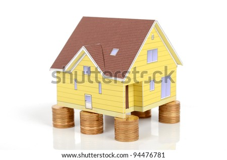 Model house and coins