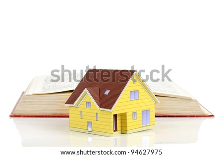 Model house and dictionary - stock photo