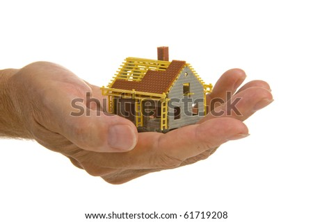 model house construction in hand - stock photo