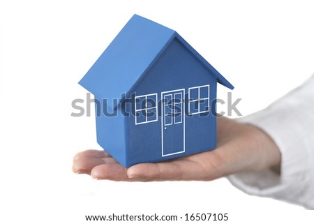 Model house held by female hand - stock photo