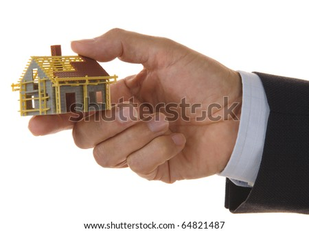 model house in business hand - stock photo