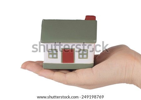 Model house in hand  isolated on white  - stock photo