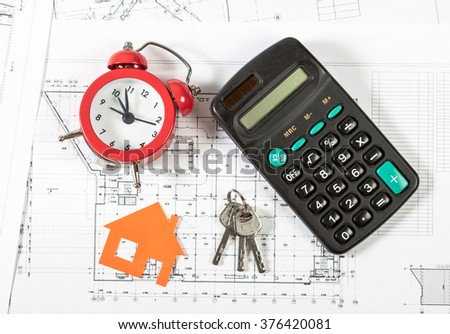 Model house on construction plan for house building, keys , red alarm clock and calculator. Real Estate Concept.