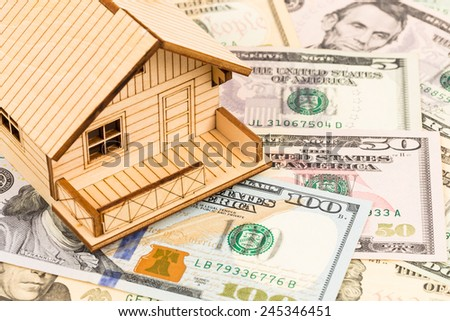 Model house on dollar banknote concept housing expense - stock photo